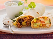 Burritos with two fillings and sour cream dip