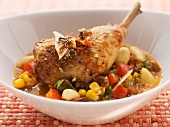 Roast chicken legs with tequila and vegetables