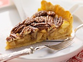 A slice of pecan and apple pie