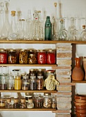 Storage jars and collection of bottles on shelving