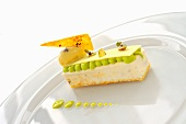 Vanilla parfait with rum and raisin ice cream, crunchy pistachios and frothy pistachio mousse