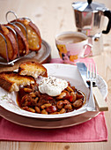 Beans with bacon, poached egg and toast