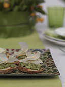 Crostini with fava beans, pears and pecorino
