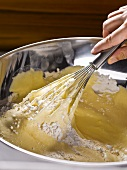 Preparing sponge mix: fold flour into egg mixture