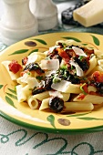 Penne rigate with black olives, tomatoes and parmesan