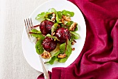 Warm red beet salad with walnuts