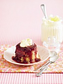 Baked pudding with raspberry sauce