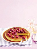 Creme caramel with raspberries