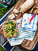 Farro sweetcorn salad and bread on a picnic basket