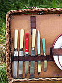 Various knives in a picnic basket