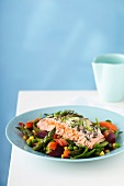 Warm vegetable salad with salmon