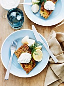 Fish fillet with a herb crust and sauce tartare