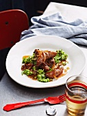 Chipolata sausages with onions and peas