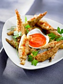 Battered sardines with pepper coulis