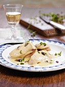 Poached chicken breast with cream sauce and herbs