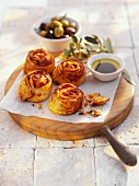 Cheese and tomato pastries, olive oil dip and olives