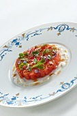Tomato tartar with edible flowers