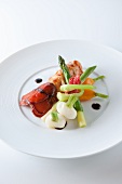 Lobster tail with spring vegetables and champagne sauce