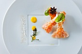 Scampi with star anise and baked mango