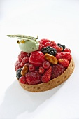 A berry tartlet with a pistachio and mascarpone dumpling