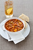 Brunswick Stew in a Bowl; Tomato, Beef and Vegetable Soup; Biscuit