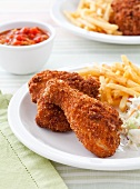 Fried Chicken with French Fries and Cole Slaw on a Plate