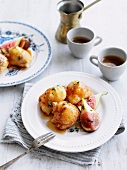 Loukoumades (fried dough balls, Greece) with honey, figs and thyme