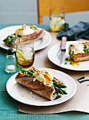 Baguette with green asparagus, poached egg and taleggio
