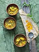 Three Bowls of Cauliflower Soup with Turmeric