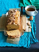 Sliced Gluten Free Walnut Banana Bread with a Cup of Tea