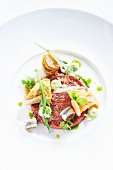 Beef tartar with marinated sardines, eruca and Chinese cabbage