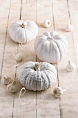 Halloween decorations: white pumpkins and garlic