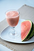 Watermelon Smoothie with a Wedge of Fresh Watermelon