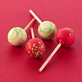 Assorted cake pops (red background)