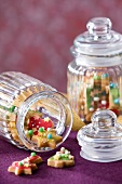 Colorfully decorated Christmas cookies in cookie jars