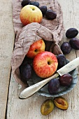 Apple and plums on a jute sack