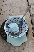Rice bowl with paper flower and spoon