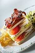 A club sandwich with egg and vegetables