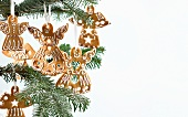 Gingerbread angels hanging on a Christmas tree