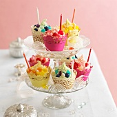 Various party cupcakes on a cake stand