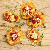 Crispy potato cakes with tomatoes, onions and cheese