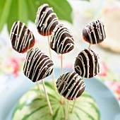 Chocolate strawberries on wooden sticks
