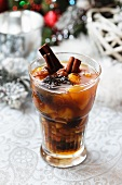 A Christmas drink with dried fruit and cinammon