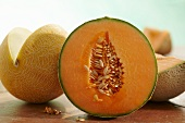 Half a cantaloupe melon and sliced galia melon