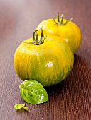 Two Green Zebra tomatoes