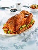 Stuffed turkey with oven-roasted vegetables