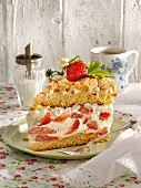 A slice of strawberry cream cake with meringue