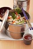 Dumplings with prawns and vegetables in a pressure cooker