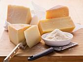 An arrangement of hard cheeses (Parmesan, Pecorino and Gouda)