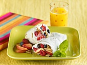 Fruit Salad Breakfast Wrap with a Glass of Orange Juice